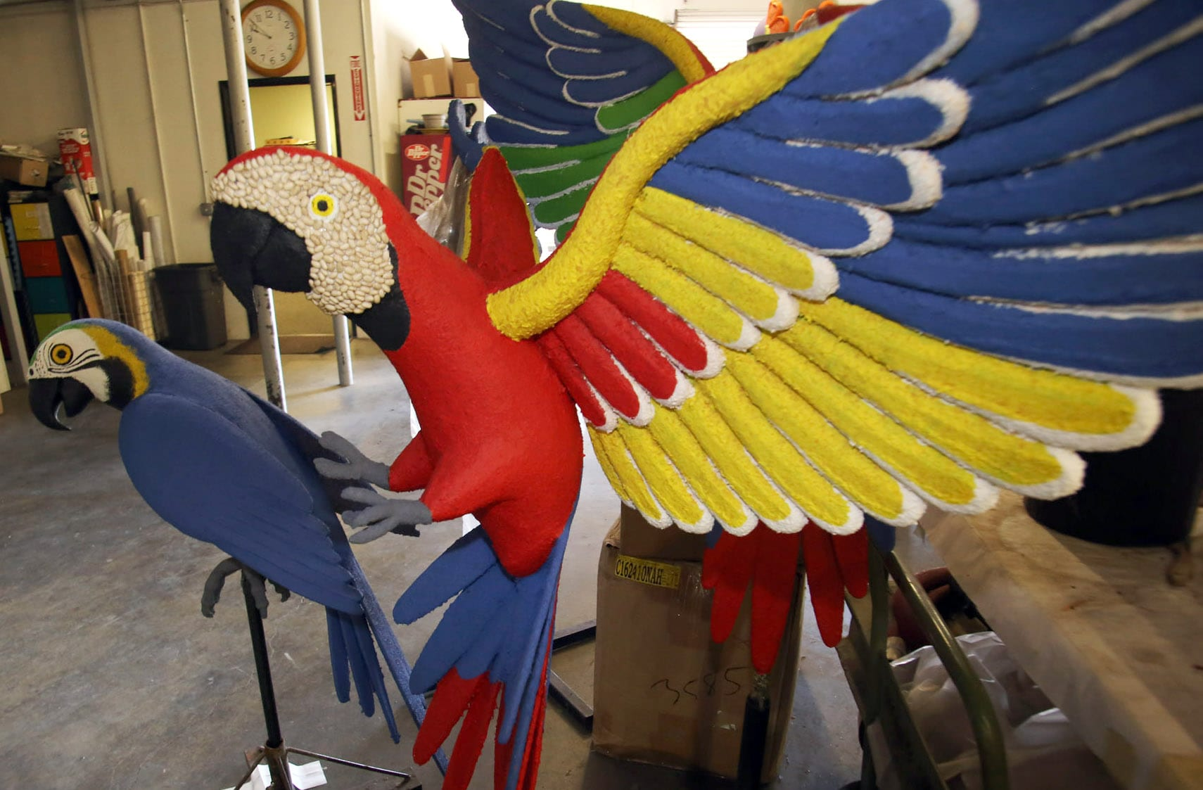 Photos as volunteers decorate Riverside's first Rose Parade float since the 1950s